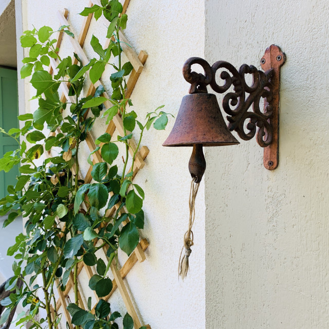 """""""Antique bell outside a French home"""" stock image"""