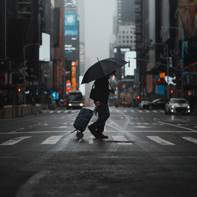"""""""Times Square under the rain during the lockdown"""" stock image"""
