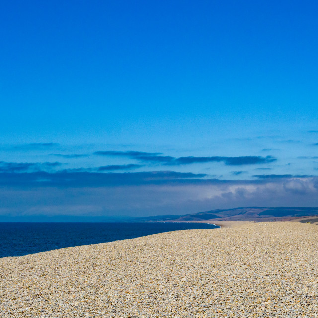 """""""Vast long stretch of pebble beach, Chesil beach, on the South West coast of England, Dorset, England, UK. Chesil beach is a popular landscape attraction in the south west of England, connecting the Isle of Portland to mainland Dorset. The 18 mile long peb"""" stock image"""
