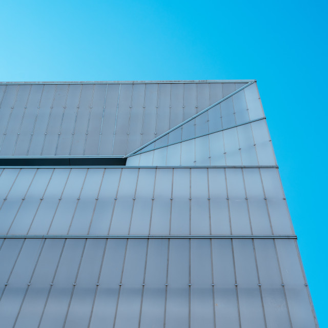 """""""Minimalist abstract modern architecture facade against blue sky"""" stock image"""
