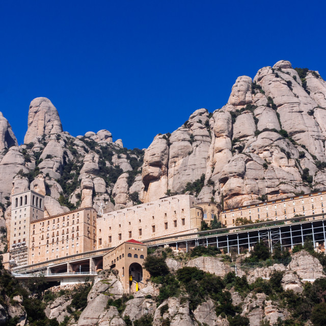 """The Santa Maria de Montserrat monastery and impressive rock form"" stock image"