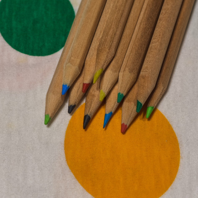 """""""colored crayons lined up on a colored plane"""" stock image"""
