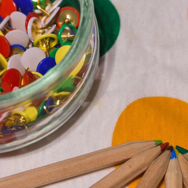 """""""colored thumbtacks in a glass jar and colored pencils horizontal"""" stock image"""