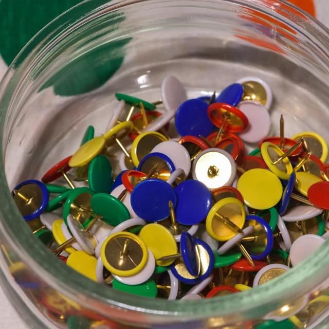 """colored thumbtacks in a glass jar"" stock image"