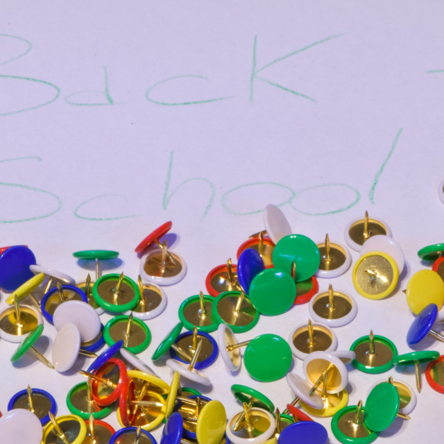 """""""thumbtacks scattered on a white paper with the words """"back to sc"""" stock image"""