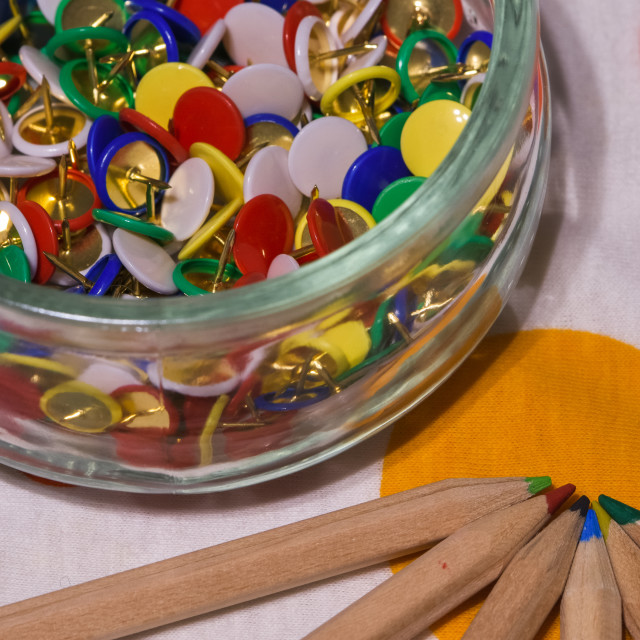 """""""colored thumbtacks in a glass jar and colored pencils"""" stock image"""