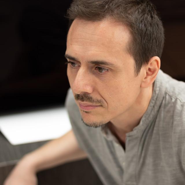 """Man profile portrait, blurred background"" stock image"