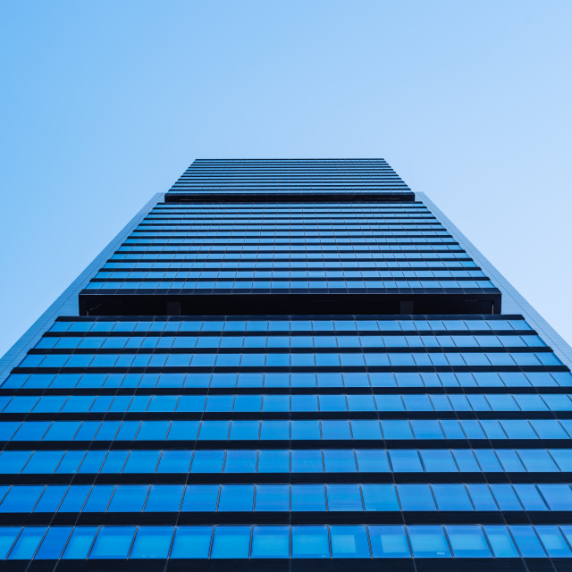 """""""Low angle view of office building in the city of Madrid against blue sky"""" stock image"""