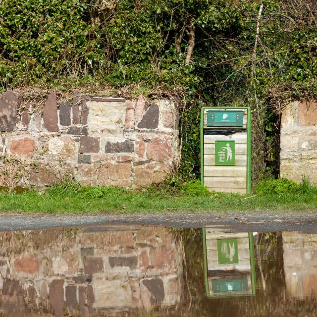 """Waste bin in a stone wall"" stock image"