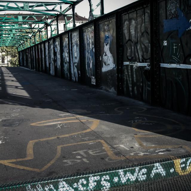 """Graffiti on pedestrian railway bridge crossing in Milan, Italy, Europe"" stock image"