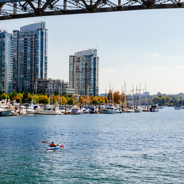 """Canoeing in the city, False Creek by Granville Street bridge, Va"" stock image"