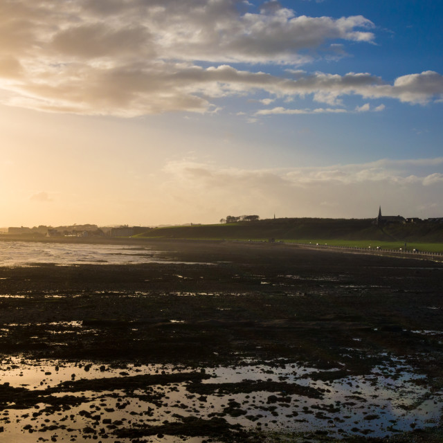 """""""Sunsetting on the beachfront by Victoria Park in Arbroath, Scotl"""" stock image"""