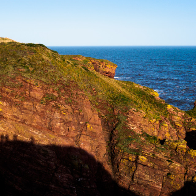 """""""Silhouette of walkers looking across a steep sandstone cliff fac"""" stock image"""
