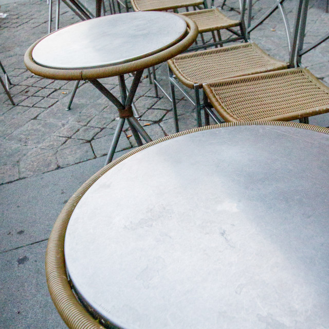 """Empty Seats and Tables at a Paris Pavement Cafe"" stock image"