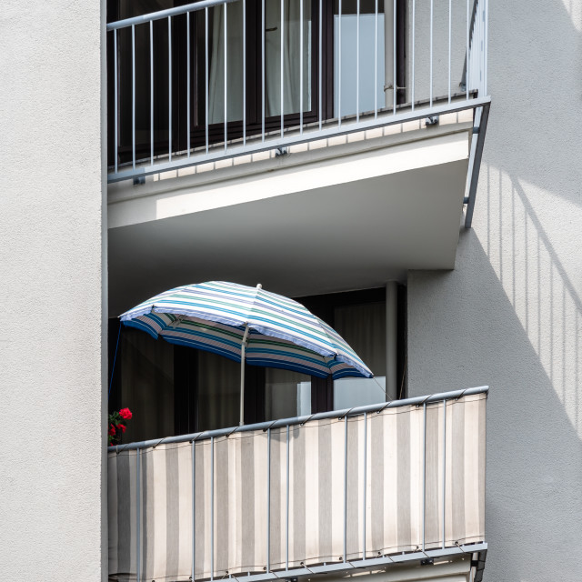 """""""Detail of a umbrella on the balcony of an apartment building in Berlin"""" stock image"""