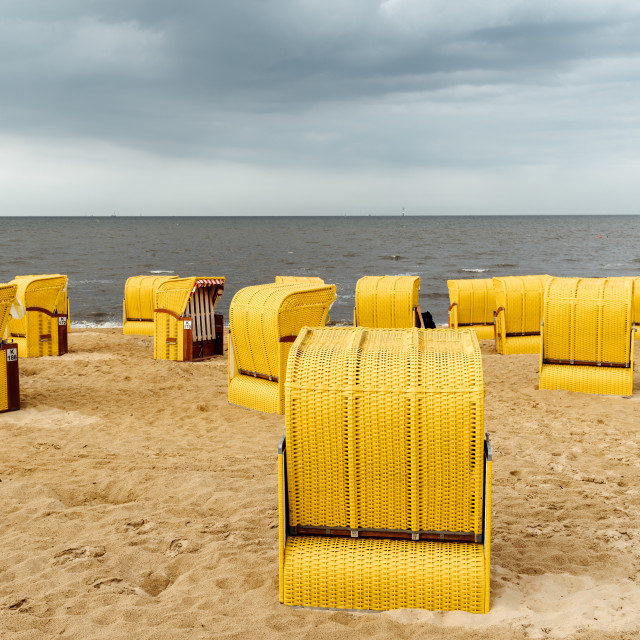 """""""Sandy beach and typical hooded beach chairs in Cuxhaven in the North Sea coast"""" stock image"""