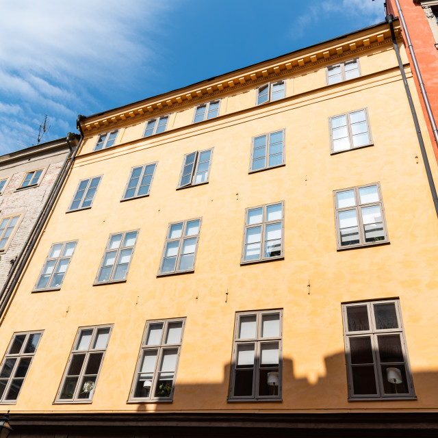 """""""Low angle view of old buildings in Gamla Stan in Stockholm"""" stock image"""