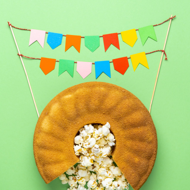 """""""Cornmeal cake with popcorn and party flags. Festa Junina celebration"""" stock image"""