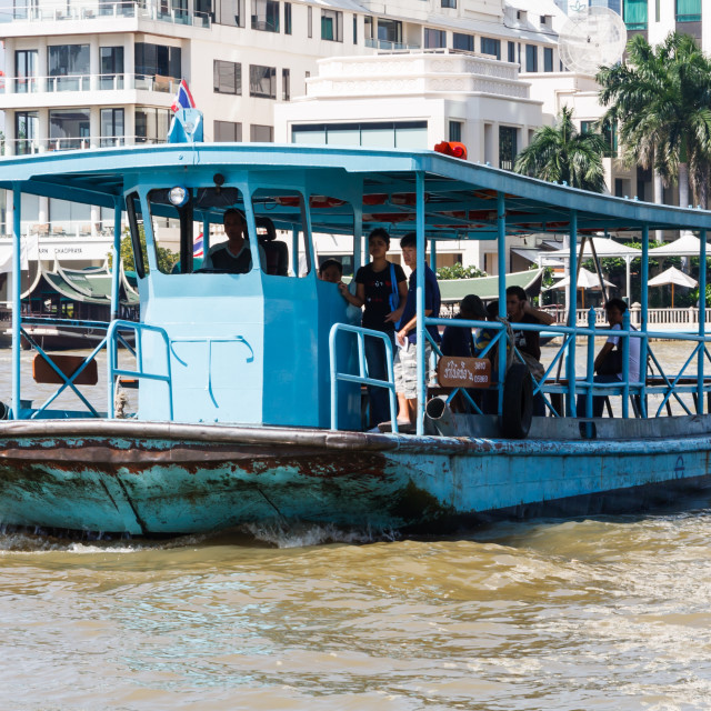 """""""A local ferry crosses the Chao Phraya river."""" stock image"""