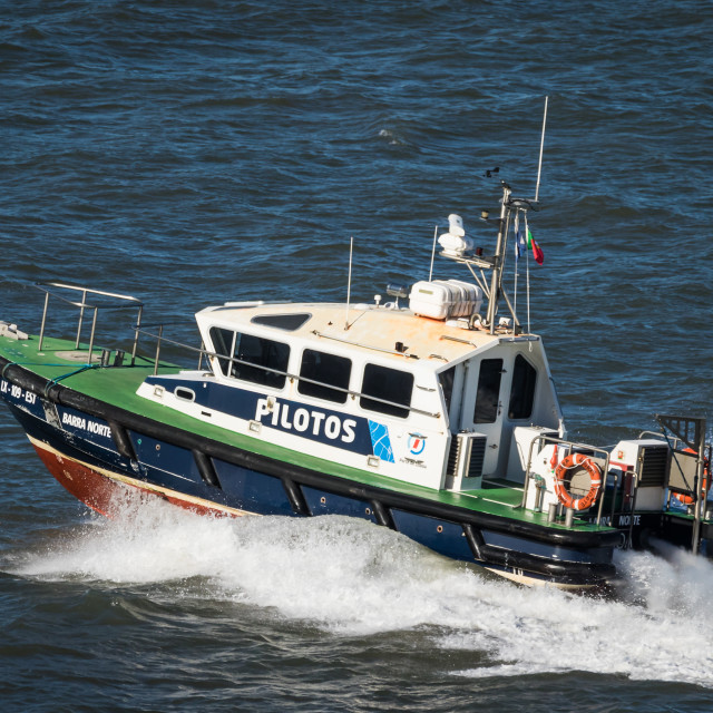 """Pilot boat ""Barra Norte"" at high speed on Tagus River"" stock image"