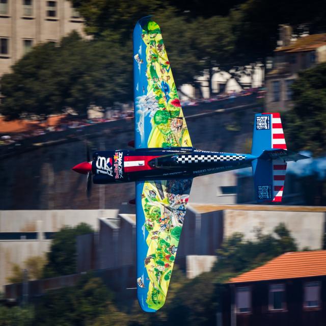 """Aerobatics aircraft flying low at high speed"" stock image"