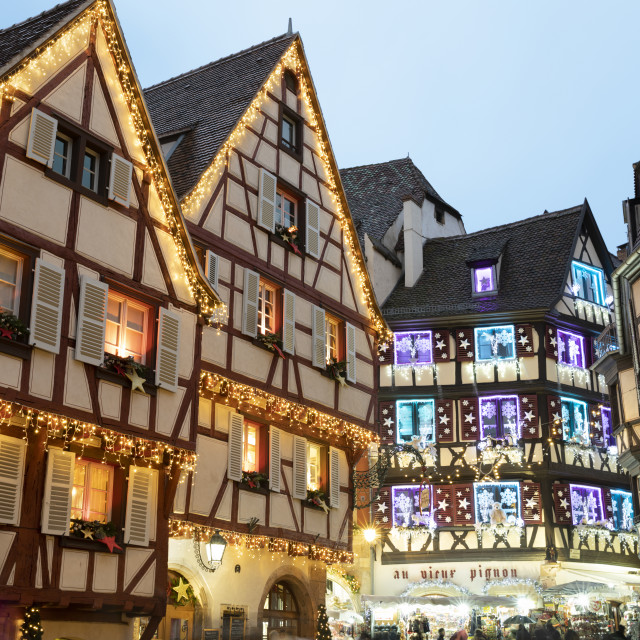 """""""Half-timbered old buildings illuminated with christmas decorations along the..."""" stock image"""