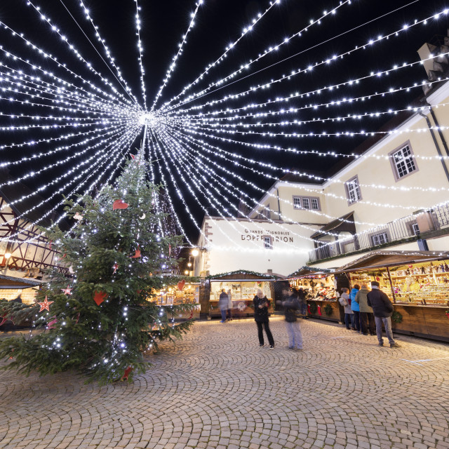 """""""Christmas market with stalls illuminated at night at the Place Fernand Zeyer,..."""" stock image"""