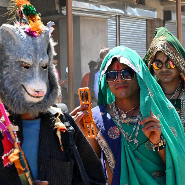 """Adavasi tribal men dressed as women and animals to celebrate Holi festival,..."" stock image"