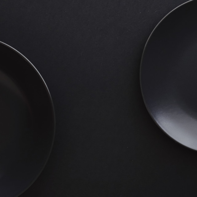 """Empty plates on black background, premium dishware for holiday dinner,..."" stock image"