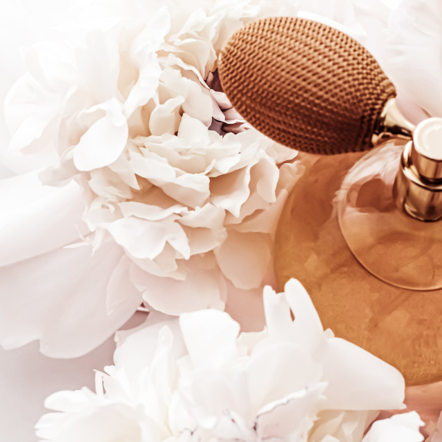 """Fragrance bottle as vintage perfume product on background of peony flowers,..."" stock image"