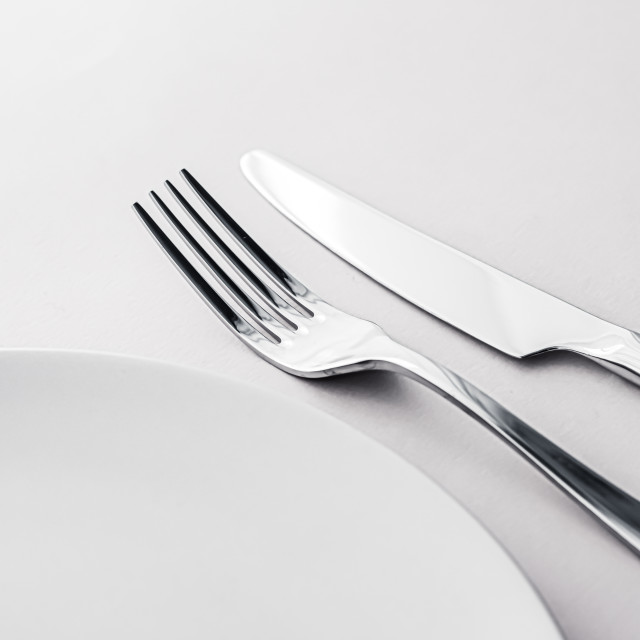 """Empty plate and cutlery as mockup set on white background, top tableware for..."" stock image"