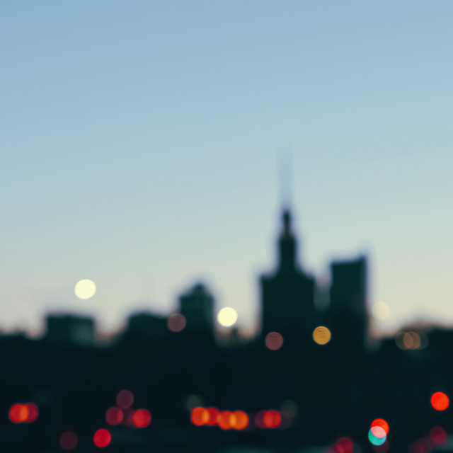 """Blurry cityscape silhouette of a European city as background, evening view"" stock image"