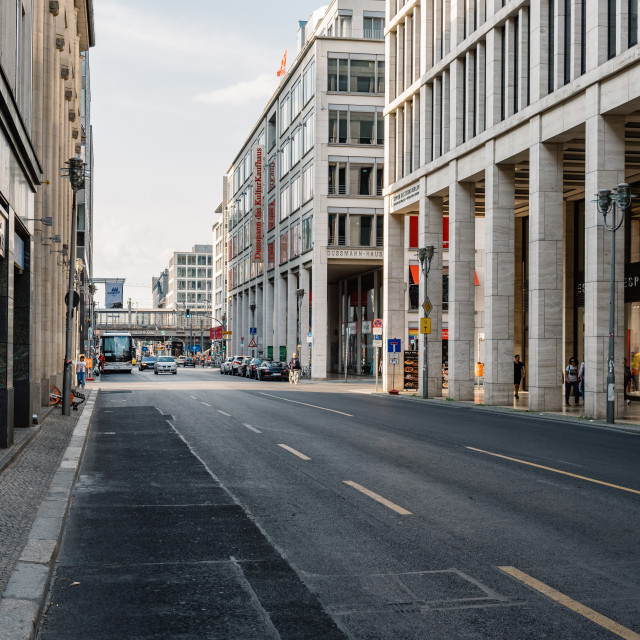 """""""Scenic view of Friedrichstrasse in Berlin with luxury stores along the colonnade"""" stock image"""