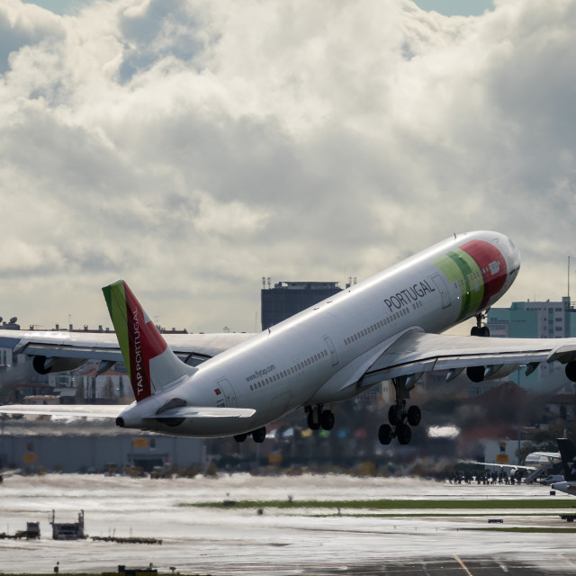 """Airliner Airbus A340 CS-TOB of TAP Air Portugal taking off"" stock image"