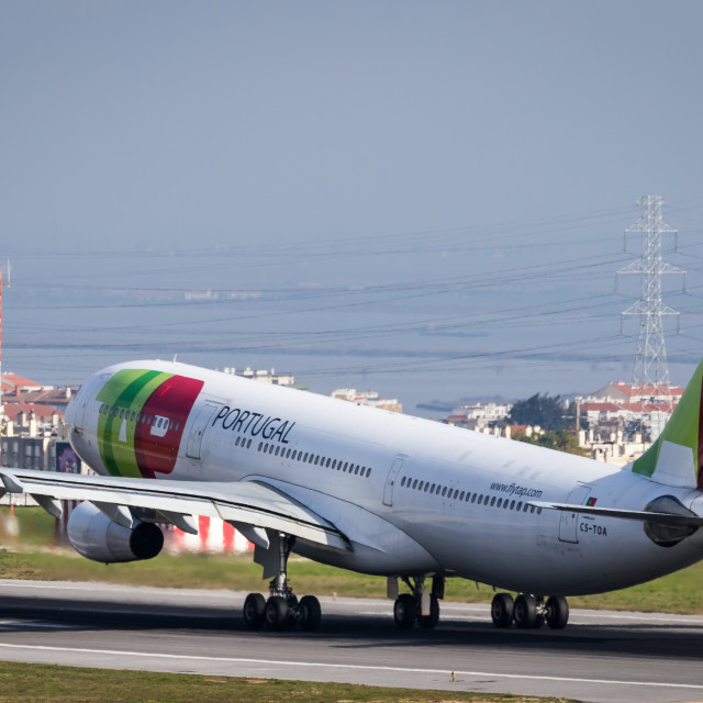 """Airliner Airbus A340 CS-TOA of TAP Air Portugal taking off"" stock image"