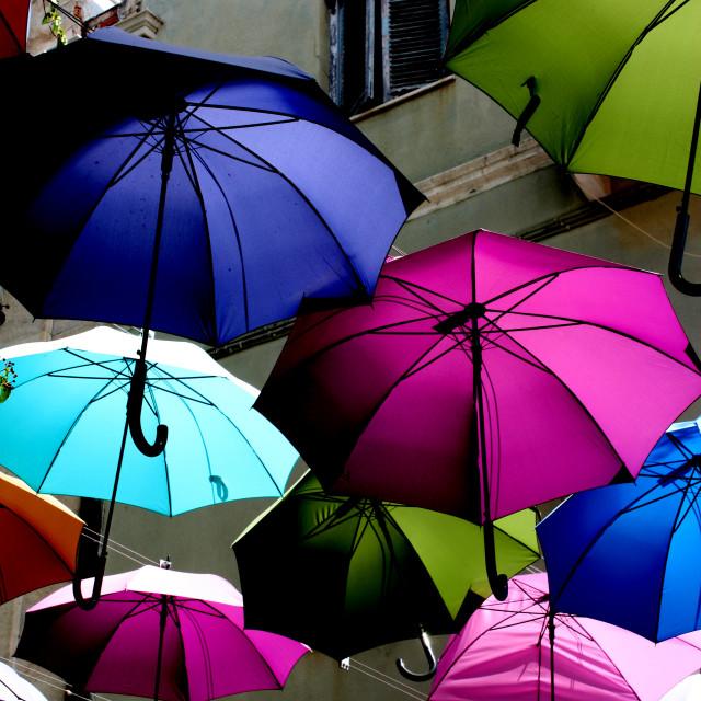 """""""Umbrellas on a street in Ermoupoli on Syros"""" stock image"""
