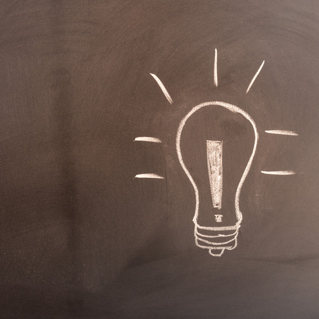 """Blackboard with a light bulb"" stock image"