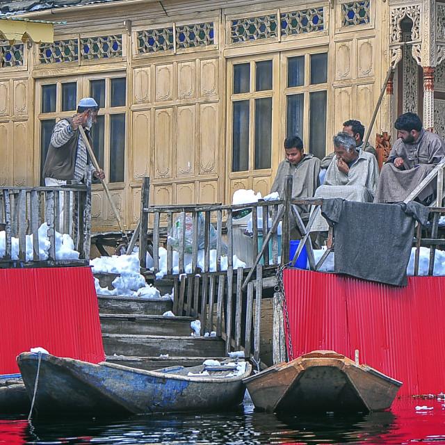 """""""Snow Removal at a House Boat at Dal Lake, Srinagar"""" stock image"""