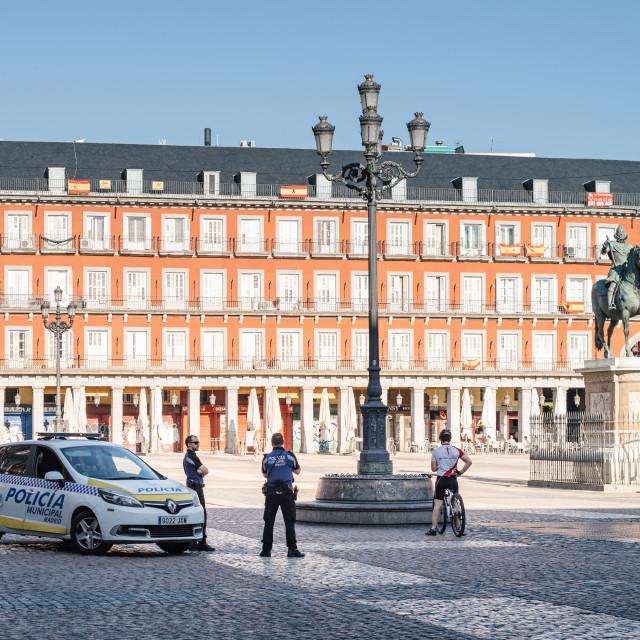 """Plaza Mayor with police car during coronavirus lockdown in Madrid"" stock image"