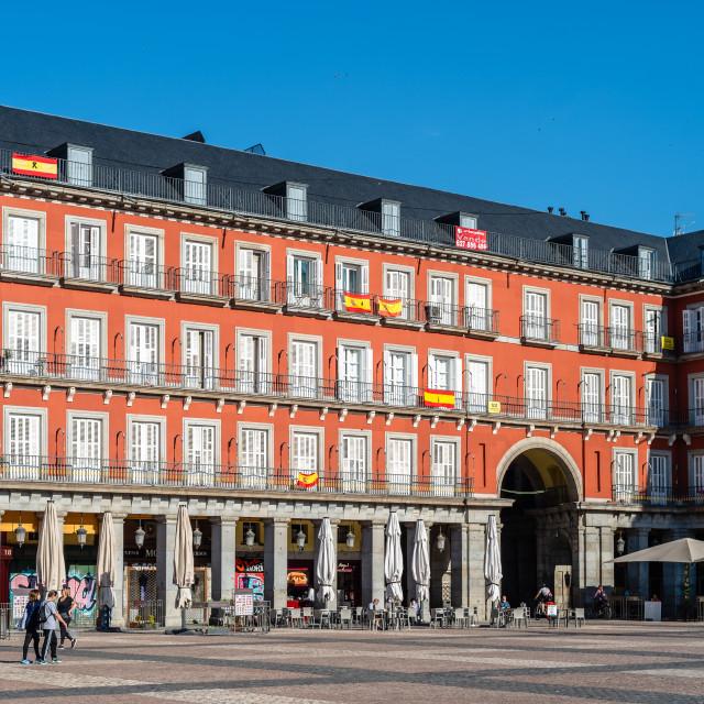 """Plaza Mayor with spanish flags in balconies during coronavirus lockdown in Madrid"" stock image"