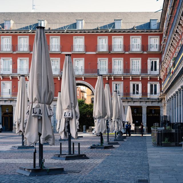 """Closed touristic terraces in Plaza Mayor during coronavirus lockdown in Madrid"" stock image"