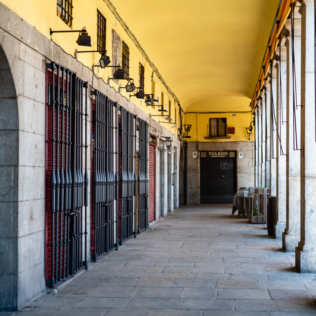 """""""Portico with closed shops in Plaza Mayor during coronavirus lockdown in Madrid"""" stock image"""