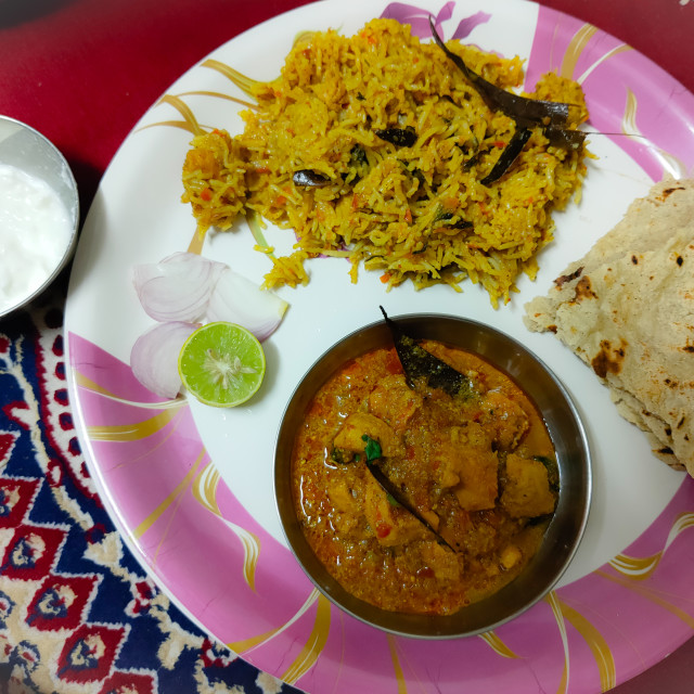 """""""Indian homemade chicken curry with chicken biryani a complete non veg meal"""" stock image"""