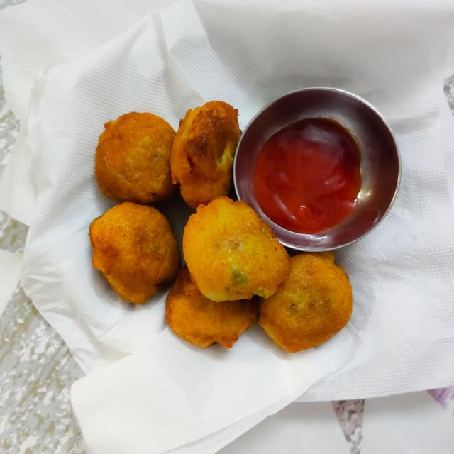 """fried potato vada with tomato sauce"" stock image"