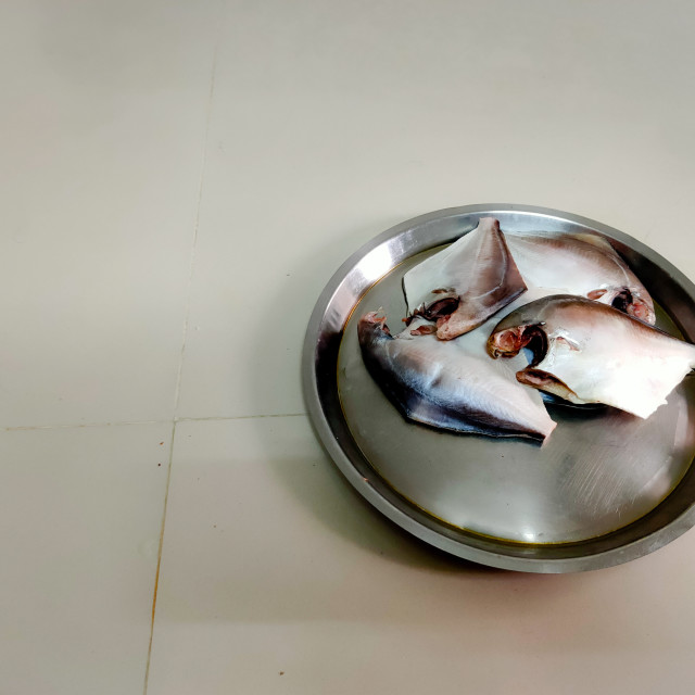"""""""pomfret fish in a steel plate"""" stock image"""