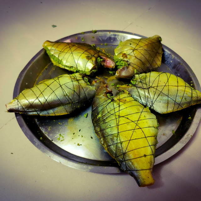 """""""grilled pomfret fish in a steel plate"""" stock image"""