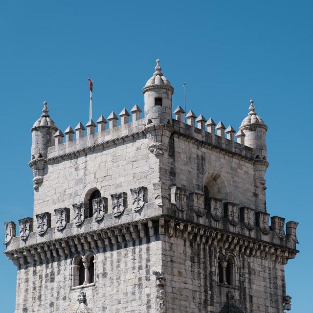 """Top part of belem tower against blue skies"" stock image"