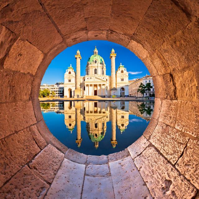 """Vienna. Karlskirche church of Vienna reflection view through stone window"" stock image"