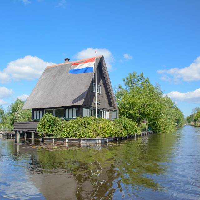 """Dutch house on a lake in the Netherlands"" stock image"