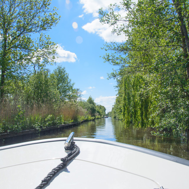 """Sailing on a boat on a canal in the Netherlands"" stock image"